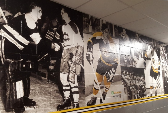 Photo mural wall inside the Boston TD Garden depicting famous Bruins moments and players.